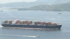 Container ship entering Hong Kong harbor Stock Footage