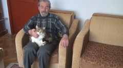 Old Man holding a beautiful cat Stock Footage