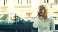 Stock Video Footage of Businesswoman talking on cellphone by the city street, steadicam shot HD