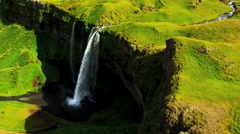 Stock Video Footage of Aerial View of Rugged Ridges & Cascading Meltwater Waterfalls, Iceland