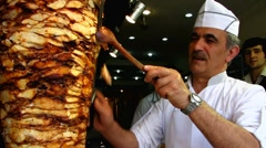 Turkey Istanbul restaurant making Durum Kebab Kebap Stock Footage