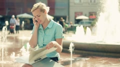 Businesswoman with cellphone and documents in the city, steadicam shot - stock footage