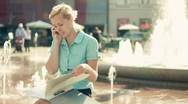 Businesswoman with cellphone and documents in the city, steadicam shot Stock Footage