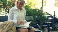 Happy businesswoman reading documents in the city, steadicam shot Stock Footage