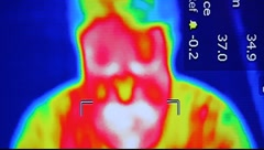 Infrared radiation thermal imaging camera of a man - stock footage