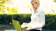 Businesswoman finishing work on laptop in the city, steadycam shot Stock Footage