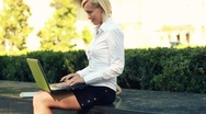 Businesswoman working on laptop in the city, steadycam shot Stock Footage