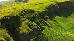 Aerial View of Mountain Ridge with Meltwater Waterfalls, Iceland Stock Footage