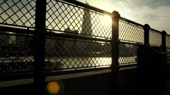 Sunset River View (boats and fence silhouette) Stock Footage