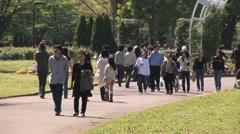 People enjoying a sunny day at the Yoyogi Park, Tokyo, Japan.  Stock Footage