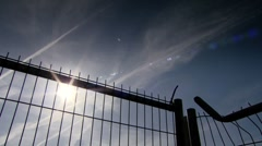 Metal fence silhouette. Sequence Stock Footage