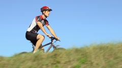 Sport activity with young man exercising on bicycle before race Stock Footage