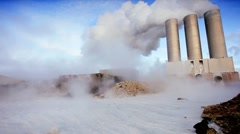 Volcanic Steam Obscuring Geothermal Power Station Stock Footage