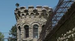 Old prison guard tower medium closeup Stock Footage