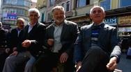 Turkey Istanbul Karakoy senior man chatting Stock Footage