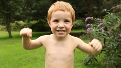 "Small Child Flexing ""muscles""(HD)c - stock footage"