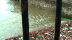 Polluted river bank _ right to left pan Stock Footage