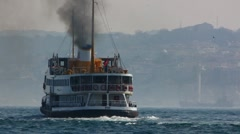 Turkey Istanbul Golden Horn ferry black polluted smoke Stock Footage