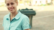 Attractive smiling woman portrait in the city, steadicam shot Stock Footage