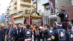 Parade o-mikoshi (portable shrines)  in Chofu, Japan. Stock Footage