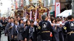 Parade o-mikoshi (portable shrines) in autumn festival, Japan. Stock Footage