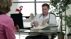 Doctor giving a prescription to patient Stock Footage