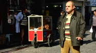 Stock Video Footage of Turkey Istanbul old town Sultanahmet street scene vendor