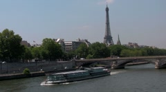 The Seine and the Eiffel Tower with riverboats in Paris, France. - stock footage