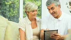 Mature Couple Having Success in Financial Planning Stock Footage
