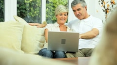 Middle Aged Couple Using Laptop at Home Stock Footage