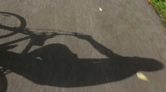 Bicycle Rider Shadow Motion on Pavement Stock Footage