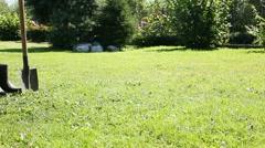 Shovel on grass Stock Footage
