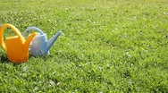 Watering can on grass Stock Footage