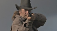 Man with Black Hat Aims Gun Stock Footage