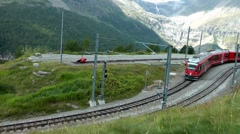 Bernina Express at Alp Grüm Station, Switzerland Stock Footage