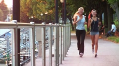 Beautiful women doing jogging; HD Photo JPEG - stock footage