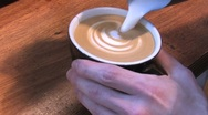 Stock Video Footage of Froth from milk makes a pattern in the cappuccino