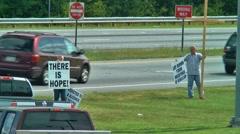 Stock Video Footage of christian witness on street corner 03