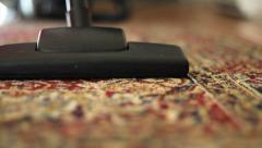 Vacuuming Colorful Carpet-Low Angle Stock Footage