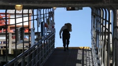 Old fisherman on gangway Stock Footage