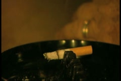 Cigarette in ashtray then pan to beer in glass Stock Footage