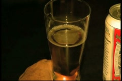Beer in glass pan in for close up and out of focus Stock Footage