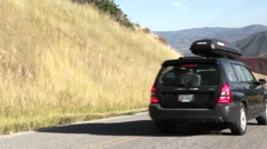 Car driving on mountain road in the fall panning shot - stock footage