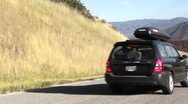 Car driving on mountain road in the fall panning shot Stock Footage