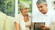 Stock Video Footage of Mature Couple Happy with Their Financial Planning