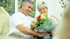 Attractive Mature Lady with Flowers from Husband Stock Footage