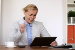 Excited businesswoman with tablet computer in the office NTSC Stock Footage