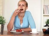 Young happy woman having breakfast NTSC Stock Footage
