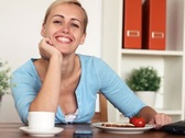 Happy woman working on laptop in home, dolly shot NTSC Stock Footage