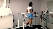Woman on a Treadmill Stock Footage